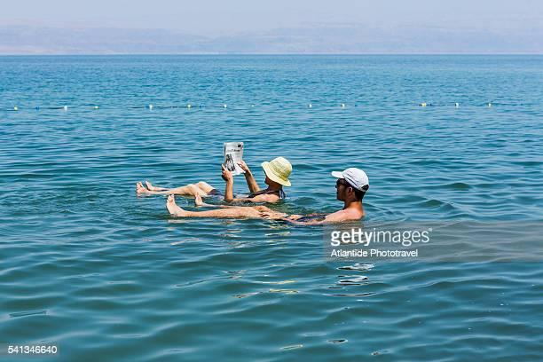 dead sea - ein gedi kibbutz, bathing in dead sea - dead sea stock pictures, royalty-free photos & images