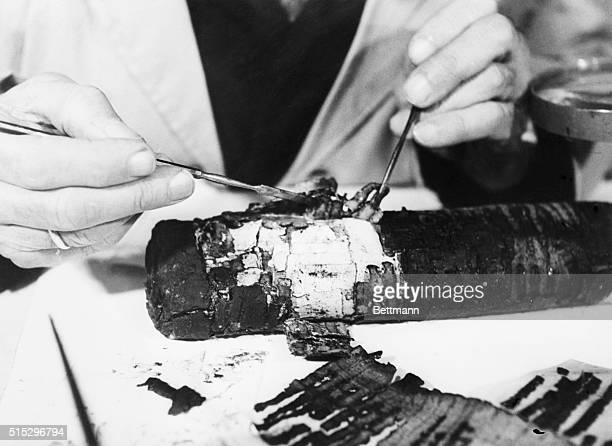 An intricate and delicate operation in process of restoring Dead Sea Scrolls is performed by Professor Bieberharant in 1955 at the Israel Special...