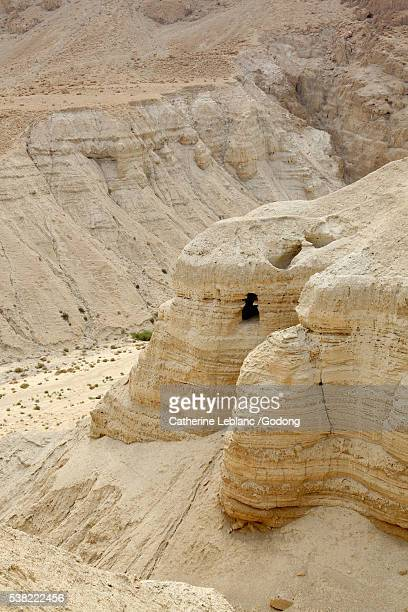 Dead Sea's caves holding ancient scrolls in Qumran. Cave No. 4 on the right side. Wadi Qumran.