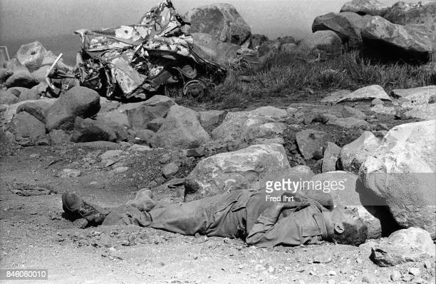 A dead soldier lying on the ground on the Golan Heights during the Yom Kippur war