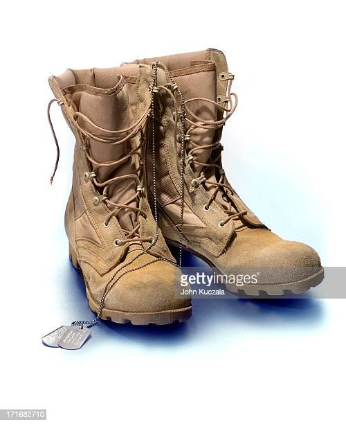 dead soldier's boots - boot stock pictures, royalty-free photos & images