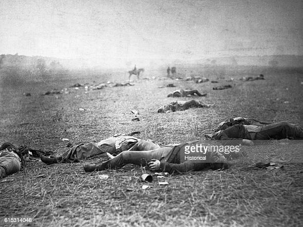 Dead soldiers lie on the battlefield at Gettysburg, where 23,000 Union troops and 25,000 Confederate troops were killed during the Civil War. July...