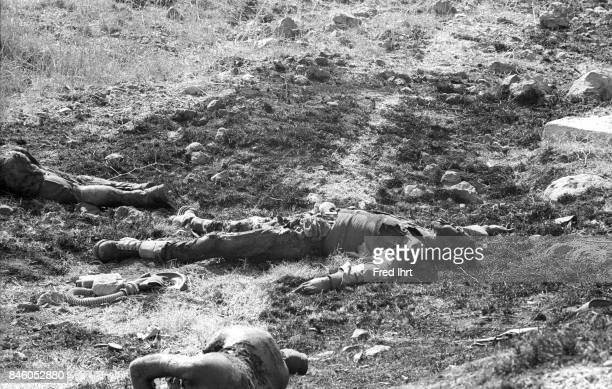 Dead soldiers lying on the ground on the Golan Heights during the Yom Kippur war