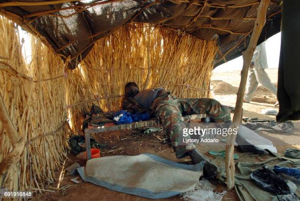 A dead Sudanese government soldier lies in a former temporary military camp for the GOS which was attacked by the NRF on October 7 near the Darfur...