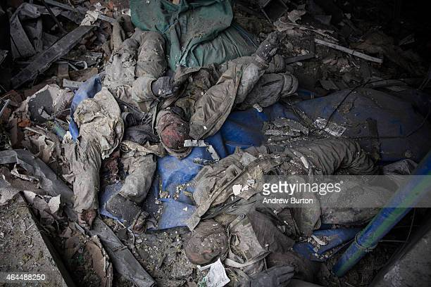 Dead Ukrainian soldiers lay amongst the wreckage of the destroyed Donetsk airport after being recovered by Ukrainian soldier prisonersofwar who were...