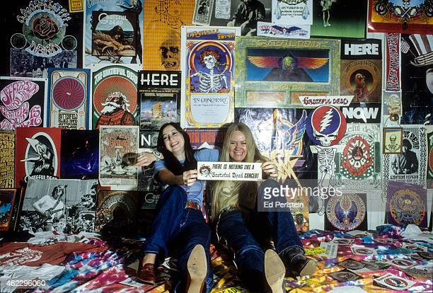 Deadheads pose in front of Grateful Dead posters at a Haight Ashbury apartment in January 1980 in San Francisco California