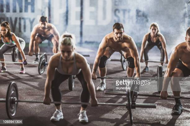 deadlift class! - weight training stock pictures, royalty-free photos & images