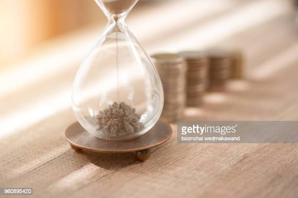 Deadline and time is money concept with hourglass