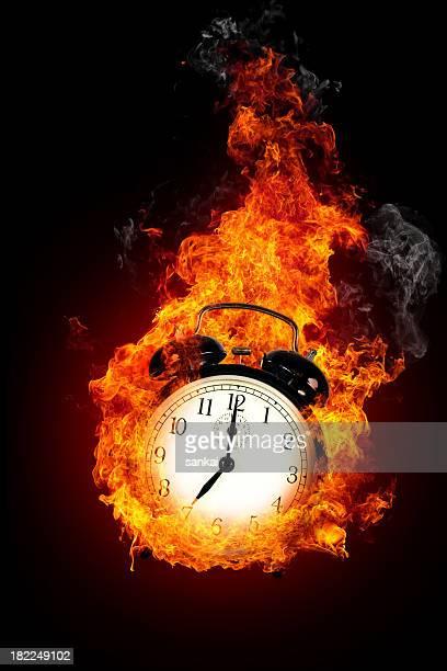 Deadline concept. Burning alarm clock.
