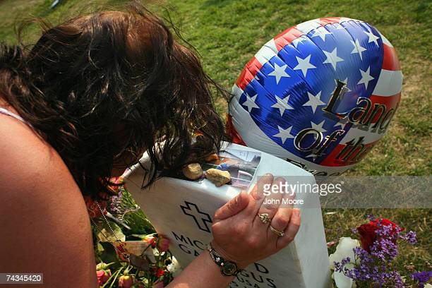 Deadra Garrigus kisses the grave of her son US Army Sgt Mickel Garrigus in 'Section 60' of the Arlington National Cemetery May 27 2007 Section 60 the...