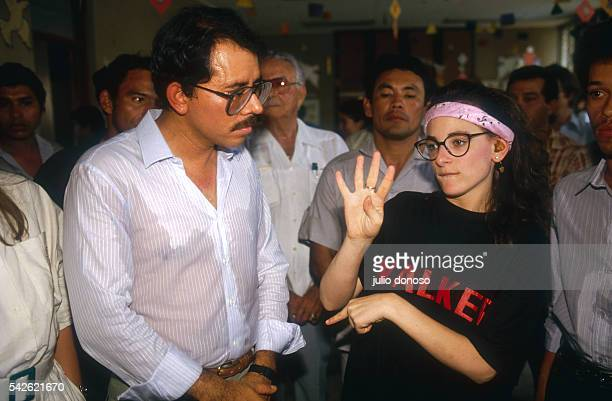 Deaf actress Marlee Matlin uses sign language to speak to Nicaraguan President Daniel Ortega and others on the set of the 1987 film Walker Filmed on...