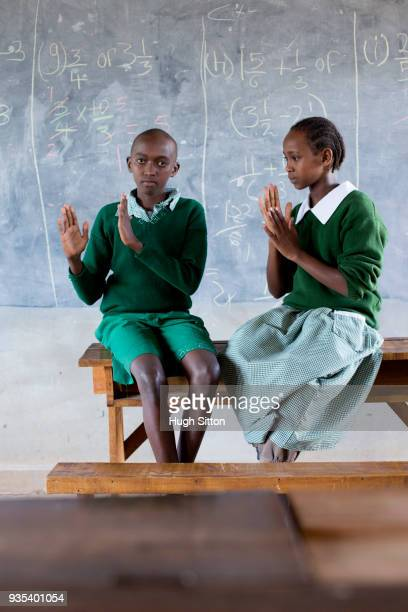 Deaf children learning sign language at school.