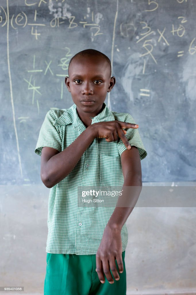 Deaf children learning sign language at school. : Stock Photo