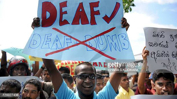 Deaf Sri Lankan protestors hold placards as they stage a rally in the streets of Colombo on July 29 2011 Protestors were demanding the implementation...