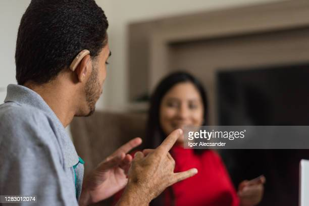deaf talking in sign language - sign stock pictures, royalty-free photos & images