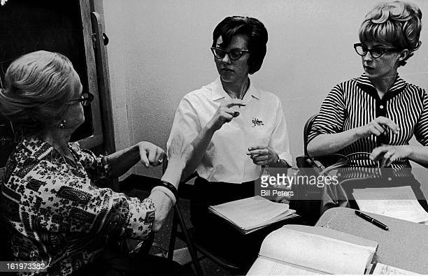 MAY 23 1967 MAR 27 1967 Deaf Volunteer Instructor Teaches Sign Language To Two Students Who Are Able To Hear Miss lone Dibble left 1420 E 13th Ave...