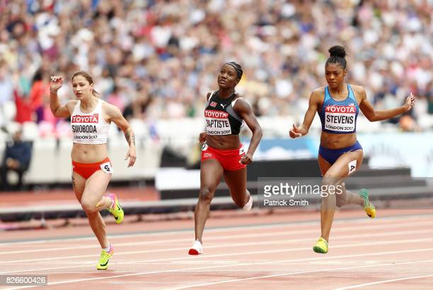 Deajah Stevens of the United States KellyAnn Baptiste of Trinidad and Tobago and Ewa Swoboda of Poland competes in the Women's 100 metres heats...