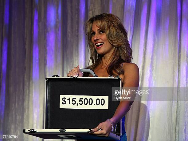 Deal or No Deal girl Patricia Kara holds a prize package for auction during the Thalians 52nd Anniversary Gala honoring Sir Roger Moore to raise...