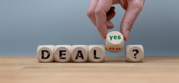 Deal or no deal? Hand turns a cube and changes the word