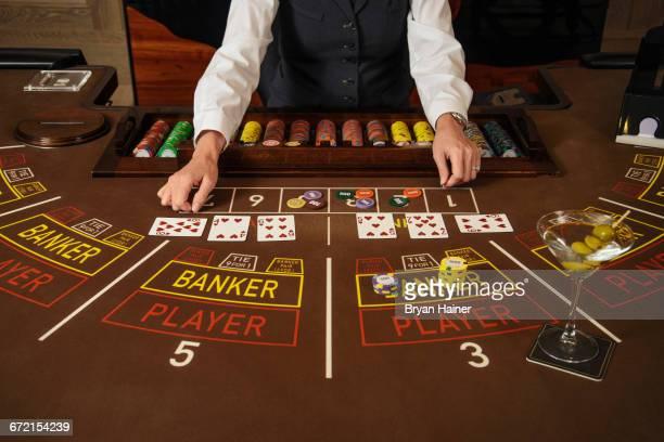Dealer at baccarat table