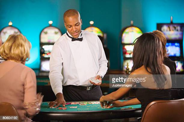 dealer at gambling table - gambling table stock pictures, royalty-free photos & images