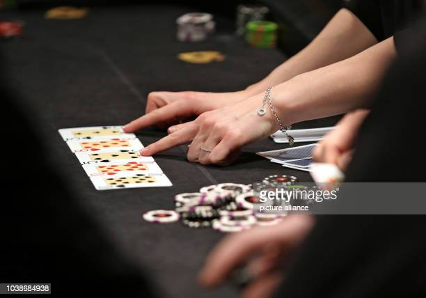 A dealer at the poker table with playing cards at the computer game festival 'DreamHack' in Leipzig Germany 22 January 2016 The Leipziger Messe is...