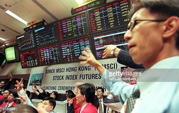 A dealer begins trading after the launching of the Singapore International Monetary Exchange and Morgan Stanley Capital International Stock Index...