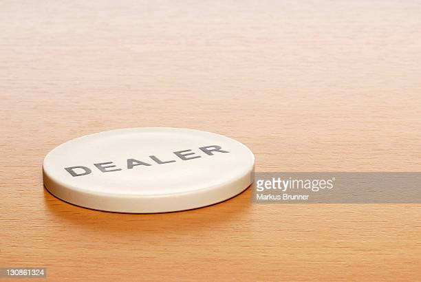 dealer chip on desk - captions stock photos and pictures