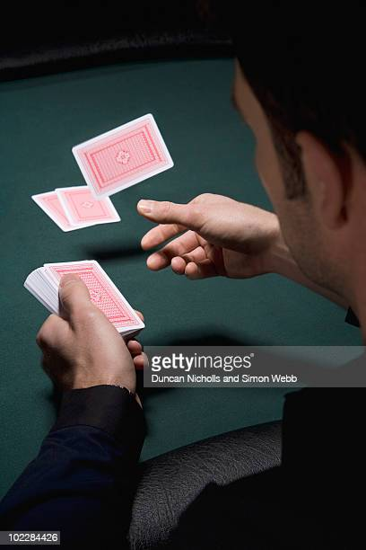 dealer dealing cards in casino - one man only stock pictures, royalty-free photos & images