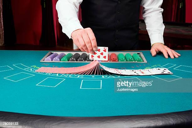 Dealer doing card trick