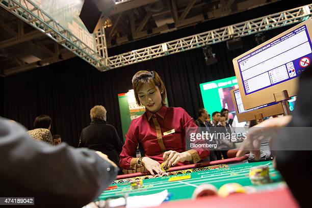 A dealer handles gaming chips at a baccarat table during the All Asia Dealers' Championship at the Global Gaming Expo inside the Venetian Macau...