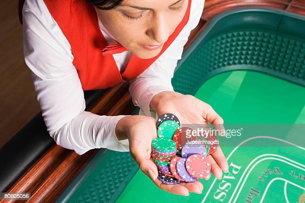 Dealer holding casino chips