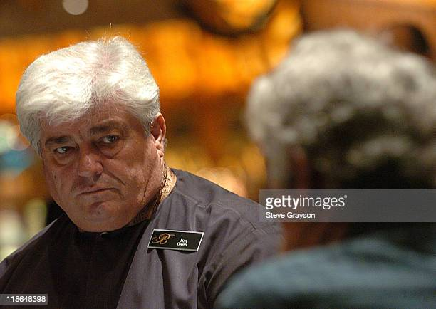 Dealer Jim Greece looks on as a player decides his next move in day two of the World Poker Tour's Doyle Brunson North American Poker Championship at...
