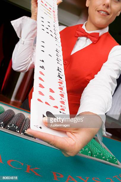 dealer shuffling cards - shuffling stock photos and pictures
