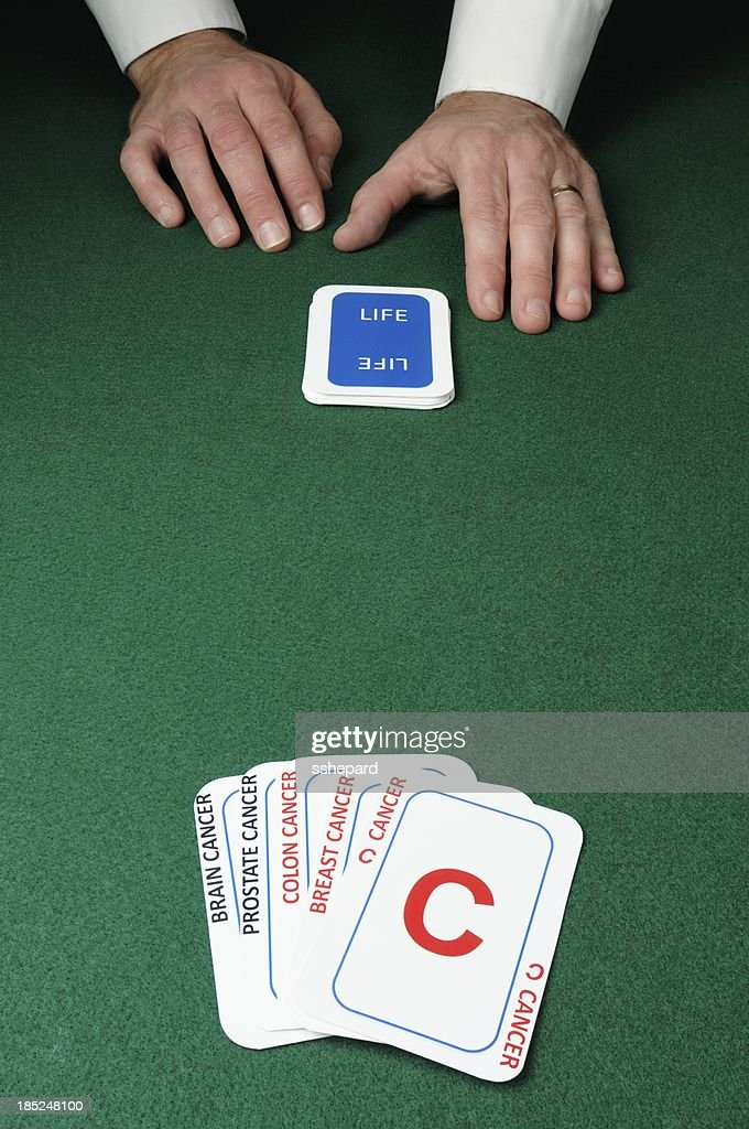 Dealer with cancer cards : Stock Photo