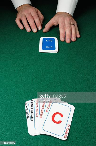 dealer with cancer cards - colorectal cancer stock photos and pictures