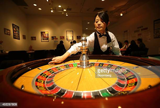 A dealer works at a roulette table at Casino Venus a mock casino operated by Japan Casino School and Bright Inc to provide the gambling experience in...