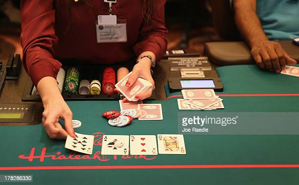 A dealer works the Blackjack table for customers in the casino that will hold its grand opening on Friday located in the Hialeah Park Race Track...