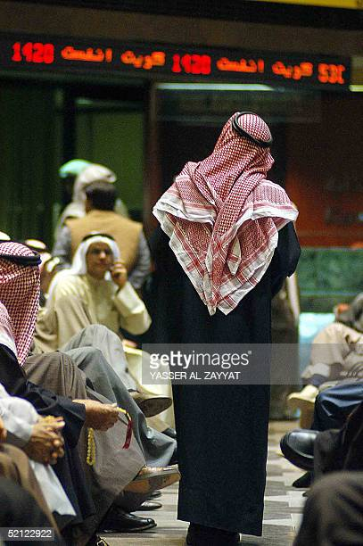 Dealers are seen at the Kuwait Stock Exchange 02 February 2005 in Kuwait City Kuwaiti shares nosedived in the week ending today sliding below the...