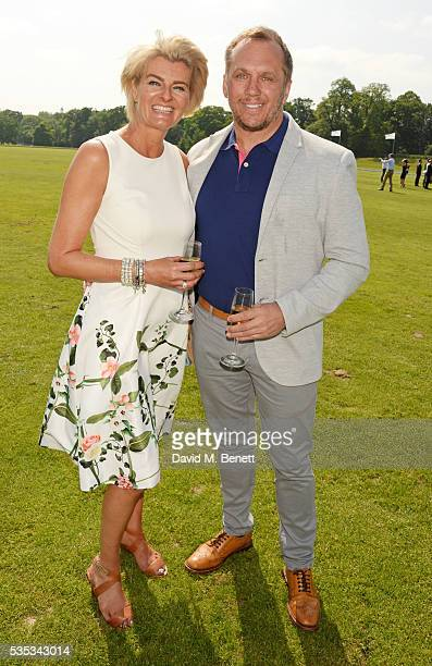 Dean Andrews and Helen Bowen-Green attend day two of the Audi Polo Challenge at Coworth Park on May 29, 2016 in London, England.