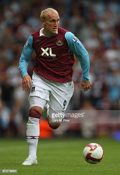 Dean Ashton of West Ham United in action during the Barclays Premier League match between West Ham United and Wigan Athletic at Upton Park on August...