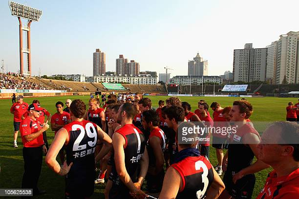 Dean Bailey coach of the Demons addresses his players during the AFL Kaspersky Cup Shanghai Showdown match between the Brisbane Lions and the...