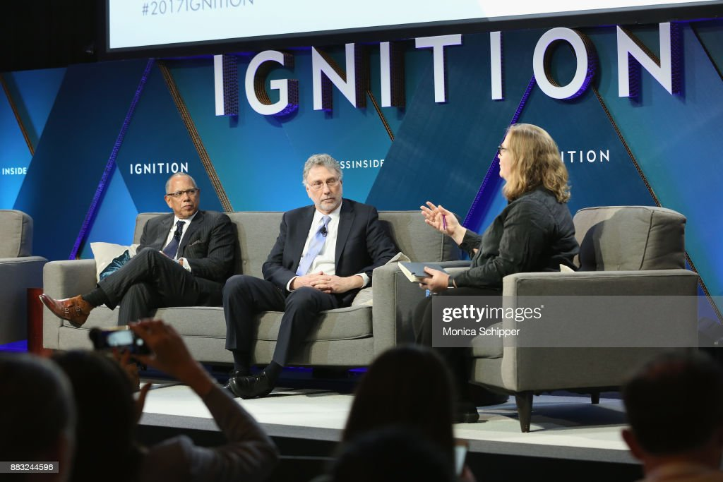 Dean Baquet, executive editor of The New York Times, and Martin Baron, executive editor of The Washington Post, speak onstage with Emily Bell, founding director of the Tow Center for Digital Journalism at Columbia University at