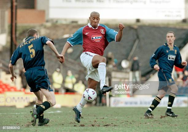 Dean Blackwell of Wimbledon challenges Dion Dublin of Aston Villa during an FA Carling Premiership match at Selhurst Park on February 21 1999 in...