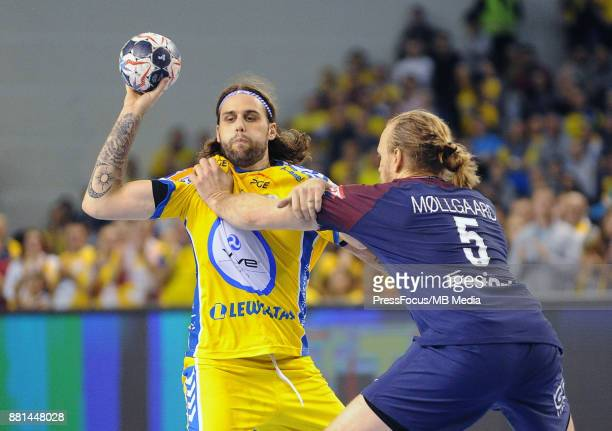 Dean Bombac Henrik Mollgaard during the EHF Men's Champions League Game between PGE Vive Kielce and PSG Handball on November 26 2017 in Kielce Poland