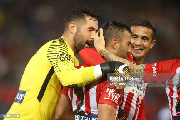 Dean Bouzanis Emmanuel Muscat and Tim Cahill of Melbourne City celebrate a goal during the round nine ALeague match between the Newcastle Jets and...