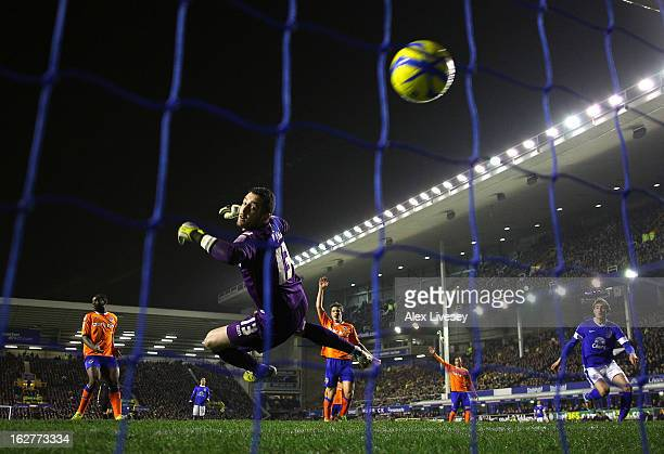 Dean Bouzanis of Oldham Athletic is beaten by Kevin Mirallas of Everton for the opening goal during the FA Cup fifth round replay match between...