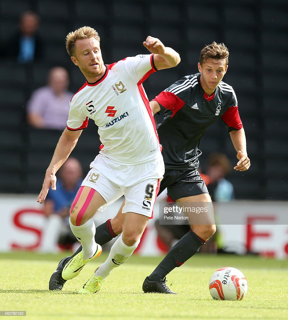 Dean Bowditch of MK Dons looks to the ball with Jorge Grant of Nottingham Forest during the Pre-Season Friendly match between MK Dons and Nottingham Forest at Stadium mk on July 27, 2014 in Milton Keynes, England.