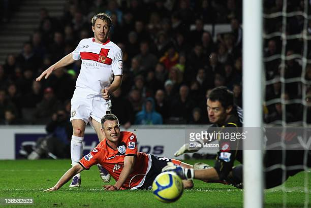 Dean Bowditch of MK Dons shoots past Radek Cerny the Queens Park Rangers goalkeeper to score during the FA Cup Third Round match between MK Dons and...