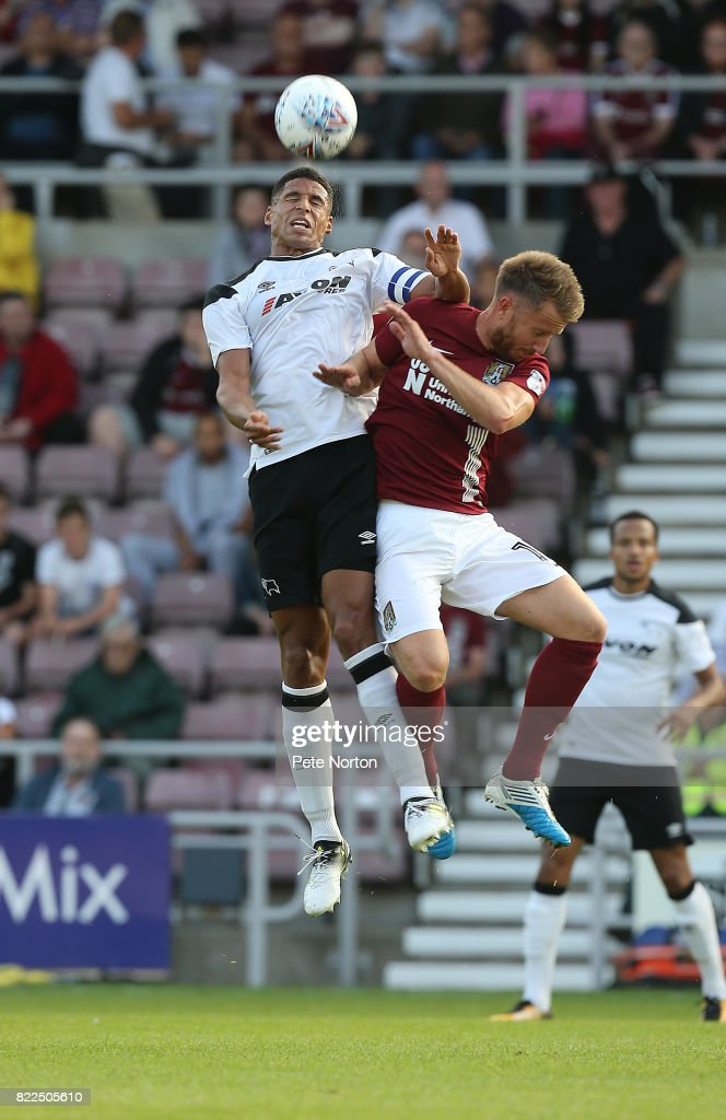 Dean Bowditch of Northampton Town contests the ball with Curtis Davies of Derby County during the Pre-Season Friendly match between Northampton Town and Derby County at Sixfields on July 25, 2017 in Northampton, England.